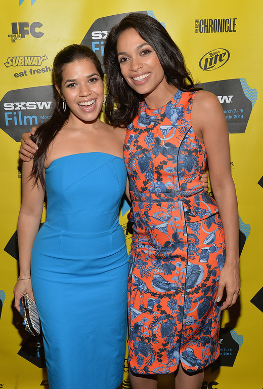 ". Actress America Ferrera (L) and actress Rosario Dawson pose in the green room for the premeire of ""Cesar Chavez\"" during the 2014 SXSW Music, Film + Interactive Festival\"" at the Paramount Theatre on March 10, 2014 in Austin, Texas.  (Photo by Michael Buckner/Getty Images for SXSW)"
