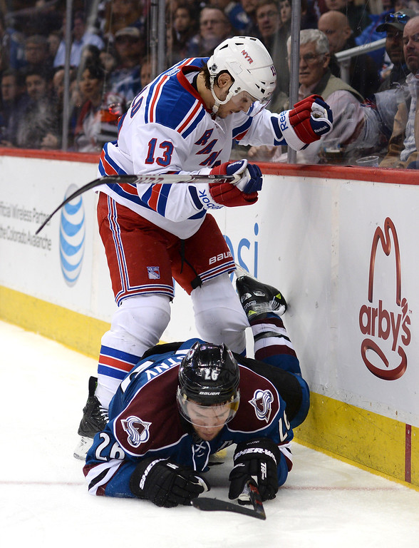 . New York wing Daniel Carcillo (13) slammed Colorado center Paul Stastny (26) into the boards in the third period.  (Photo by Karl Gehring/The Denver Post)