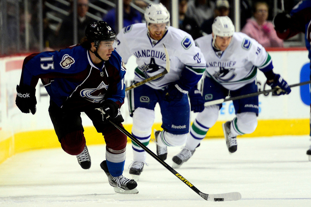 . DENVER, CO - MARCH 24: P.A. Parenteau (15) of the Colorado Avalanche gets the puck ahead of the Vancouver Canucks defense before making an assist to Jamie McGinn (11) of the Colorado Avalanche to tie the game at 1-1 during the first period of action. Colorado Avalanche versus the Vancouver Canucks at the Pepsi Center. (Photo by AAron Ontiveroz/The Denver Post)