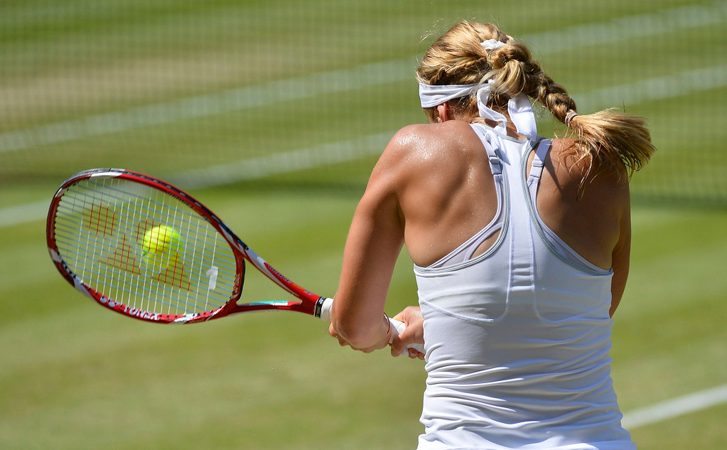 . Sabine Lisicki of Germany hits a return to Marion Bartoli of France during their women\'s singles final tennis match at the Wimbledon Tennis Championships, in London July 6, 2013.      REUTERS/Toby Melville