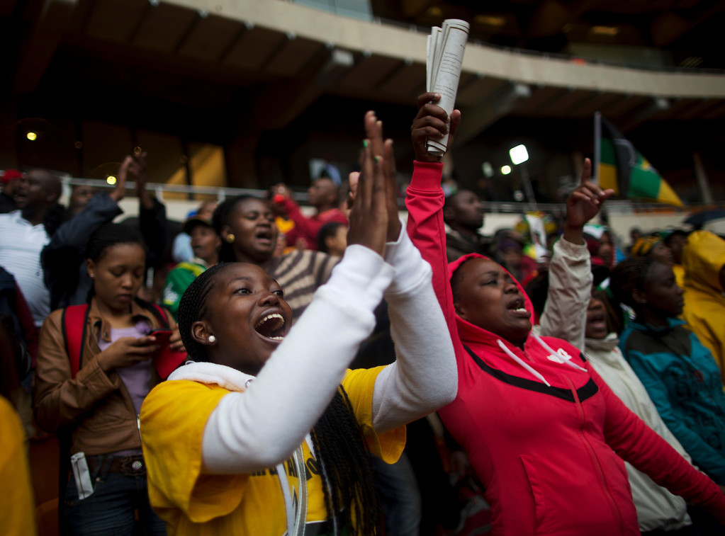 . Mourners sing inside of FNB Stadium as they wait for the memorial service for former South African president Nelson Mandela in Soweto near Johannesburg, Tuesday, Dec. 10, 2013. (AP Photo/)