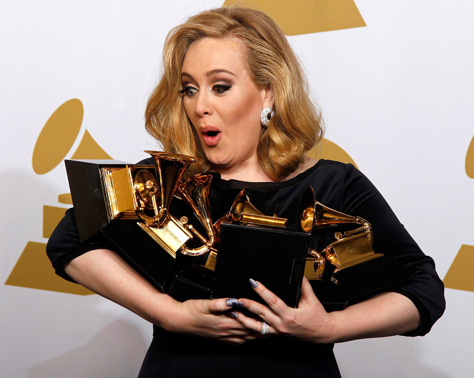 ". Singer Adele holds her six Grammy Awards at the 54th annual Grammy Awards in Los Angeles, California February 12, 2012. Soul singer Adele triumphed in her return to music\'s stage on Sunday, scooping up six Grammys and winning every category in which she was nominated including album of the year for ""21\"" and best record with \""Rolling In the Deep.\""    REUTERS/Lucy Nicholson"