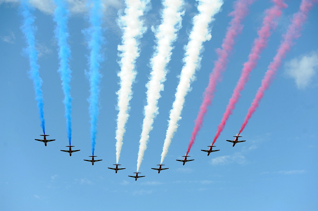 . The Red Arrows perform a fly-past above Harewood House, near Leeds, northern England on July 5, 2014 at the ceremonial start of the Tour de France. The 2014 Tour de France got underway on July 5, 2014 on the streets of Leeds and ends on July 27, 2014 on the Champs-Elysees in Paris. ASADOUR GUZELIAN/AFP/Getty Images