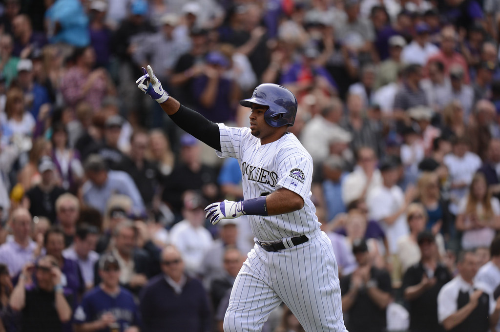 . Wilin Rosario (20) of the Colorado Rockies rounds the bases after hitting a home run in the fourth inning. (Photo by Hyoung Chang/The Denver Post)