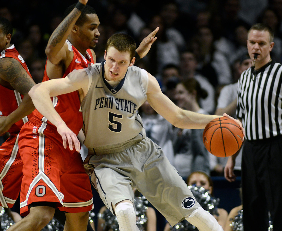 . Penn State\'s Donovon Jack (5) works around Ohio State\'s LaQuinton Ross during the second half of an NCAA college basketball game on Thursday, Feb. 27, 2014 in State College, Pa. Penn State won 65-63. (AP Photo/Ralph Wilson)