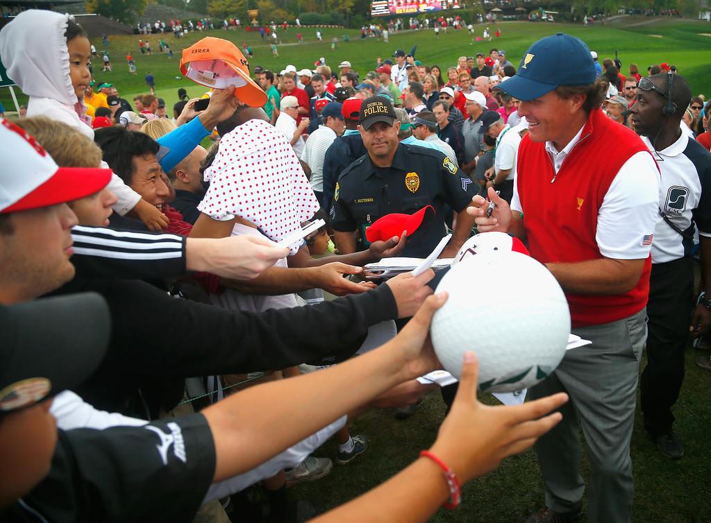. Phil Mickelson of the U.S. Team signs autographs after the U.S. Team defeated the International Team 18.5 to 15.5 after the Day Four Singles Matches at the Muirfield Village Golf Club on October 6, 2013  in Dublin, Ohio.  (Photo by Matt Sullivan/Getty Images)