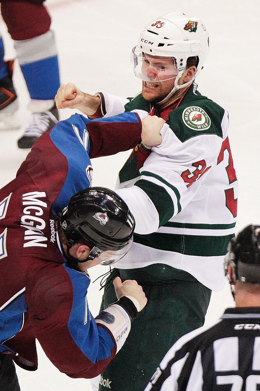 . Colorado Avalanche\'s Jamie McGinn, bottom, and Minnesota Wild\'s Darcy Kuemper, top, fight during the third period of an NHL hockey game on Thursday, Jan. 30, 2014 in Denver. The Avalanche won 5-4. (AP Photo/Barry Gutierrez)