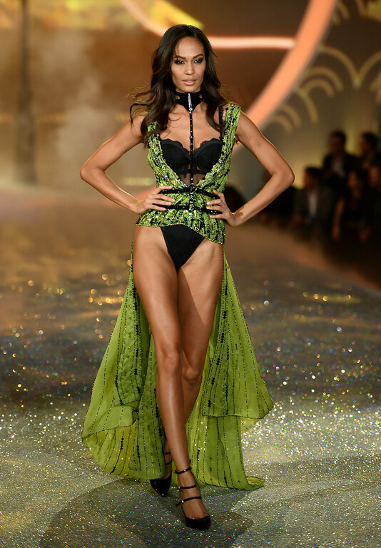 . Model Joan Smalls walks the runway at the 2013 Victoria\'s Secret Fashion Show at Lexington Avenue Armory on November 13, 2013 in New York City.  (Photo by Dimitrios Kambouris/Getty Images for Victoria\'s Secret)
