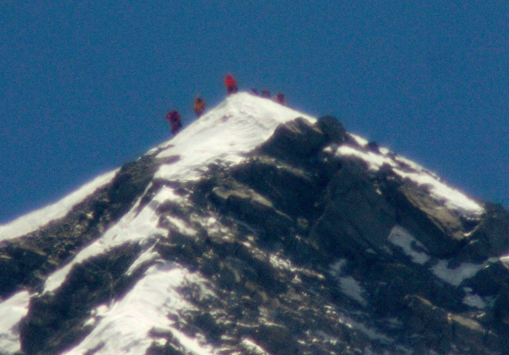 . A team of climbers, including 80-year-old Japanese mountaineer Yuichiro Miura, stand on the summit of Mount Everest, in this photo taken by Kyodo May 23, 2013.   He was accompanied by three other Japanese, including his son, and six Nepali sherpas.  REUTERS/Kyodo