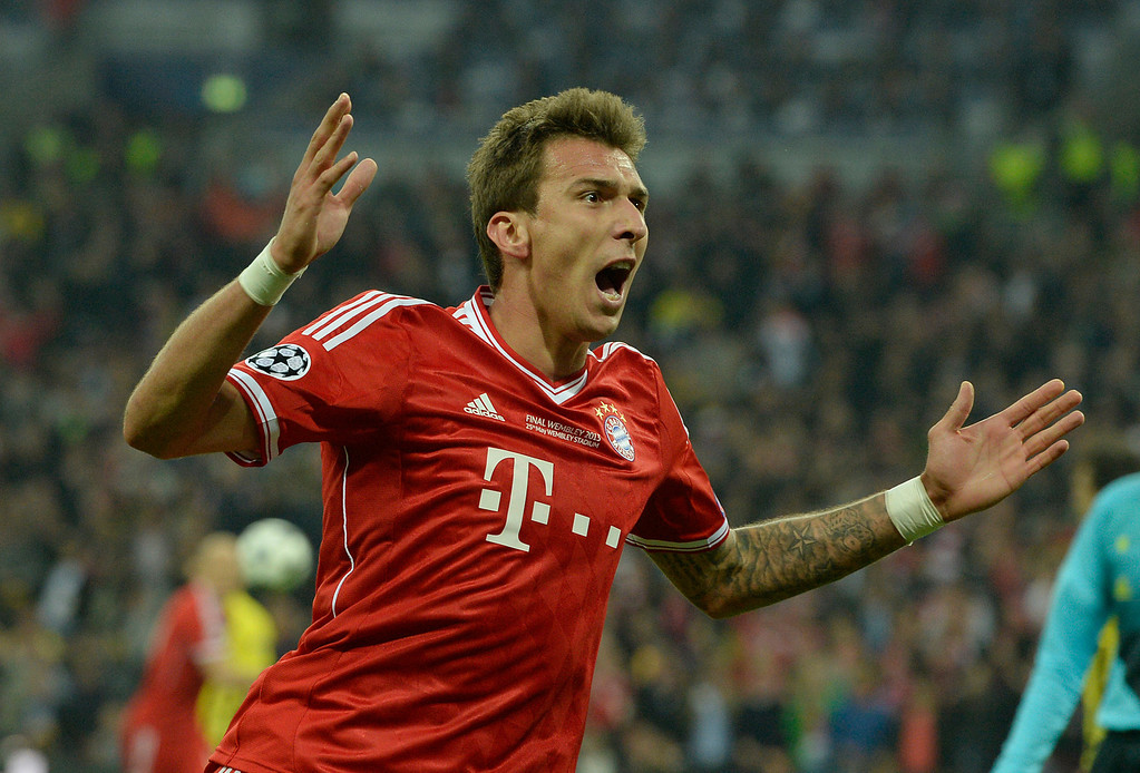 . Bayern Munich\'s Croatian striker Mario Mandzukic celebrates scoring the opening goal of the UEFA Champions League final football match between Borussia Dortmund and Bayern Munich at Wembley Stadium in London on May 25, 2013  CHRISTOF STACHE/AFP/Getty Images