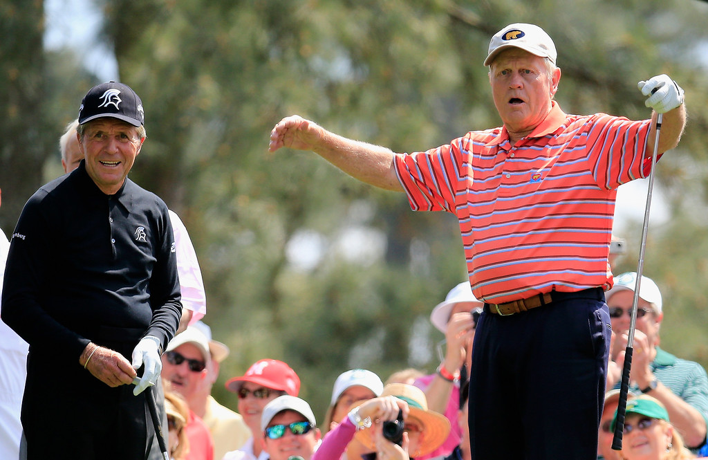 . Jack Nicklaus (R) reacts to the crowd after teeing off as Gary Player looks on during the 2014 Par 3 Contest prior to the start of the 2014 Masters Tournament at Augusta National Golf Club on April 9, 2014 in Augusta, Georgia.  (Photo by Rob Carr/Getty Images)