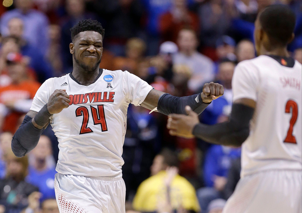 . Louisville\'s Montrezl Harrell (24) reacts with Russ Smith (2) during the first half of an NCAA Midwest Regional semifinal college basketball tournament game against the Kentucky Friday, March 28, 2014, in Indianapolis. (AP Photo/Michael Conroy)