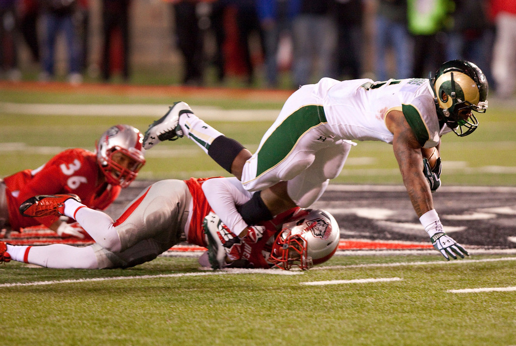 . Colorado State running back Kapri Bibbs is tackled by New Mexico\'s Ryan Santos in the second half of an NCAA college football game Saturday, Nov. 16, 2013 in Albuquerque, N.M. Bibbs rushed for six touchdowns and ran 291 yards in Colorado State\'s 66-42 win.  (AP Photo/Eric Draper)