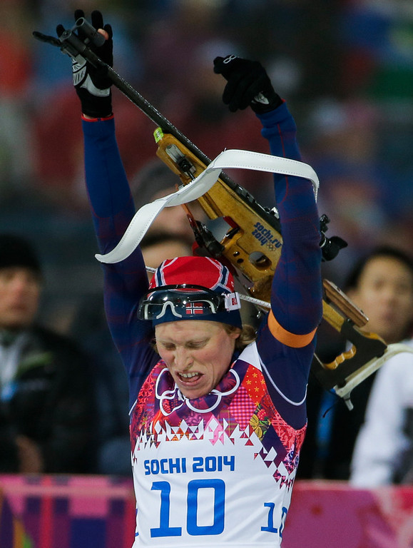 . Norway\'s Tora Berger leaves the shooting range on her way to win the silver medal in the women\'s biathlon 10k pursuit, at the 2014 Winter Olympics, Tuesday, Feb. 11, 2014, in Krasnaya Polyana, Russia. (AP Photo/Gero Breloer)