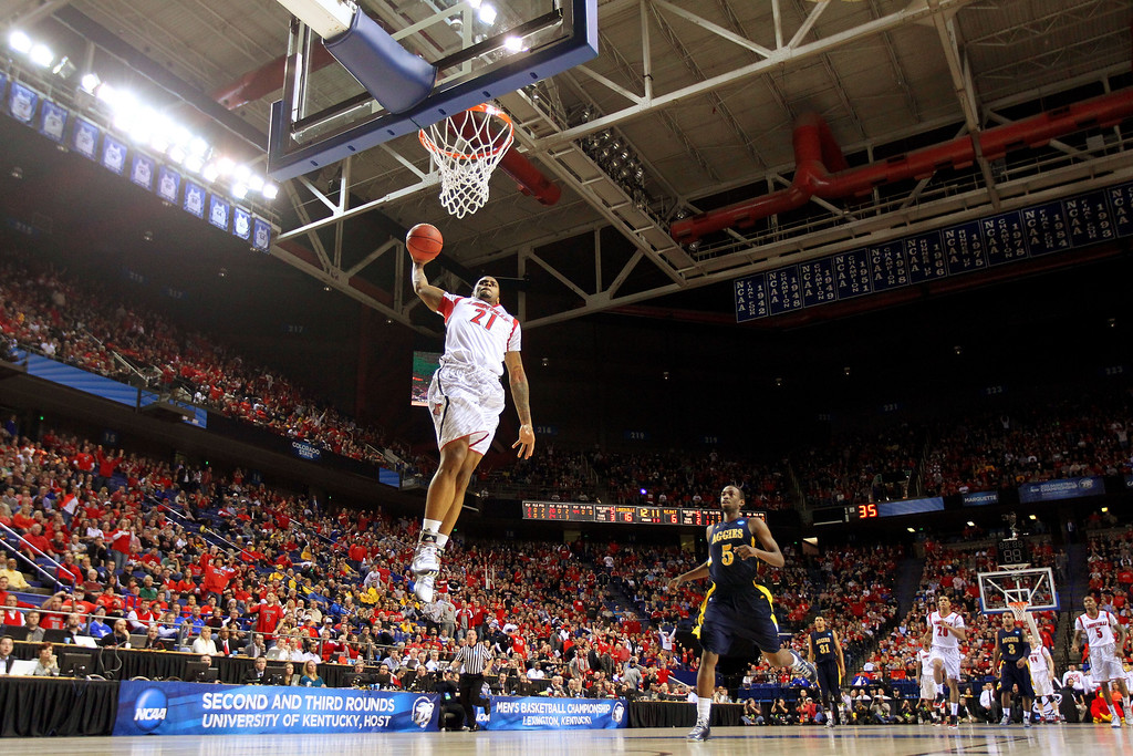 . LEXINGTON, KY - MARCH 21:  Chane Behanan #21 of the Louisville Cardinals goes up for a dunk that he would miss against the North Carolina A&T Aggies during the second round of the 2013 NCAA Men\'s Basketball Tournament at the Rupp Arena on March 21, 2013 in Lexington, Kentucky.  (Photo by Andy Lyons/Getty Images)