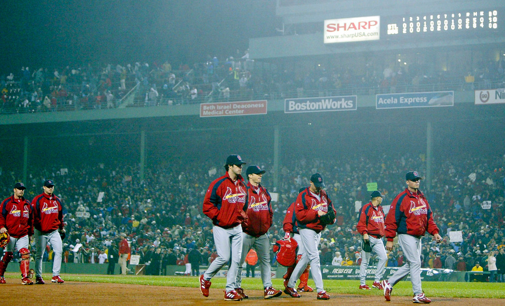 . ** CORRECTS TO ST. LOUIS CARDINALS PLAYERS NOT BOSTON RED SOX ** St. Louis Cardinals players jog off the field after losing Game 2 of the World Series against the Boston Red Sox in Boston, Sunday, Oct. 24, 2004. The Red Sox won 6-2.  (AP Photo/Winslow Townson)