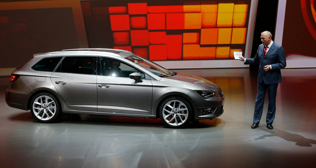 . Seat CEO Juergen Stackmann shows the new Seat Leon ST during a preview of the Volkswagen Group prior to the 65th Frankfurt Auto Show in Frankfurt, Germany, Monday, Sept. 9, 2013. More than 1,000 exhibitors will show their products to the public from Sept. 12 through Sept.22, 2013. (AP Photo/Frank Augstein)