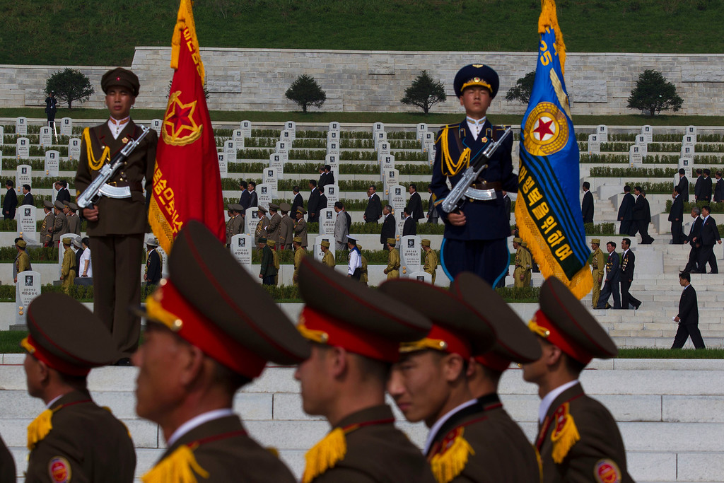 . North Koreans tour a cemetery for Korean War veterans on Thursday, July 25, 2013 in Pyongyang, North Korea  during an opening ceremony marking the 60th anniversary of the signing of the armistice that ended hostilities on the Korean peninsula. (AP Photo/David Guttenfelder)