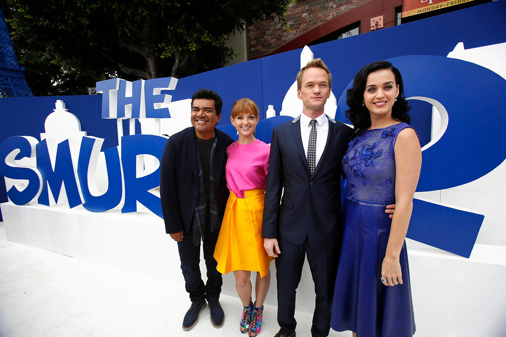 """. Cast members (R-L) Katy Perry, Neil Patrick Harris, Jayma Mays and George Lopez pose at the premiere of \""""The Smurfs 2\"""" at the Regency Village theatre in Los Angeles, California July 28, 2013. The movie opens in the U.S. on July 31.  REUTERS/Mario Anzuoni"""