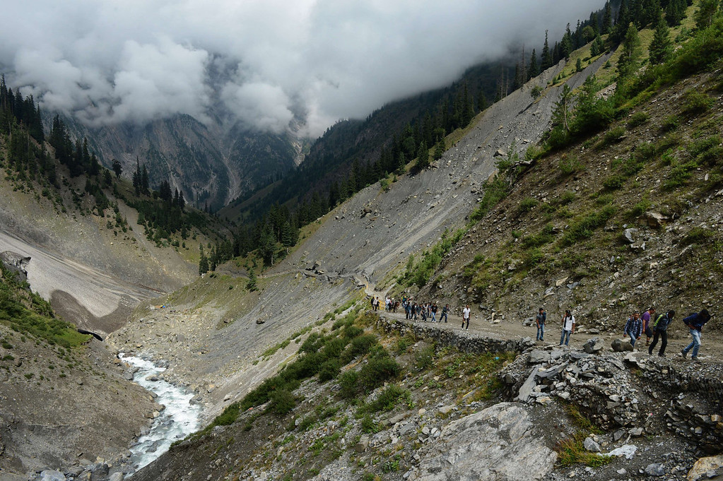 . Hindu devotees walk during their pilgrimage from Baltal Base Camp to the holy Amarnath Cave Shrine, in Baltal on August 18, 2013. Every year, hundreds of thousands of pilgrims trek through treacherous mountains in revolt-torn Kashmir, along icy streams, glacier-fed lakes and frozen passes, to reach the Amarnath cave, located at an altitude of 3,857 meters (12,729 feet), where a Shiva Lingam, an ice stalagmite shaped as a phallus and symbolizing the Hindu God Shiva, stands for worship.   TAUSEEF MUSTAFA/AFP/Getty Images