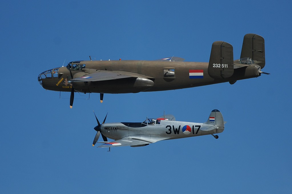 . A Dutch B-25 Mitchell (top) and Spitfire fly over Arromanches-les-Bains, Normandy, on June 6, 2014, a joint French-Dutch D-Day commemoration ceremony marking the 70th anniversary of the World War II Allied landings in Normandy.  AFP PHOTO / JEAN-SEBASTIEN  EVRARD/AFP/Getty Images