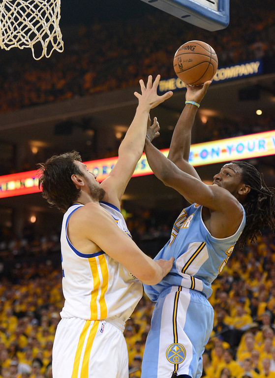 . OAKLAND, CA. - APRIL 26: Kenneth Faried (35) of the Denver Nuggets takes a shot over Andrew Bogut (12) of the Golden State Warriors during the second quarter in game 3 of the first round of the NBA Playoffs April 26, 2013 at Oracle Arena.  (Photo By John Leyba/The Denver Post)