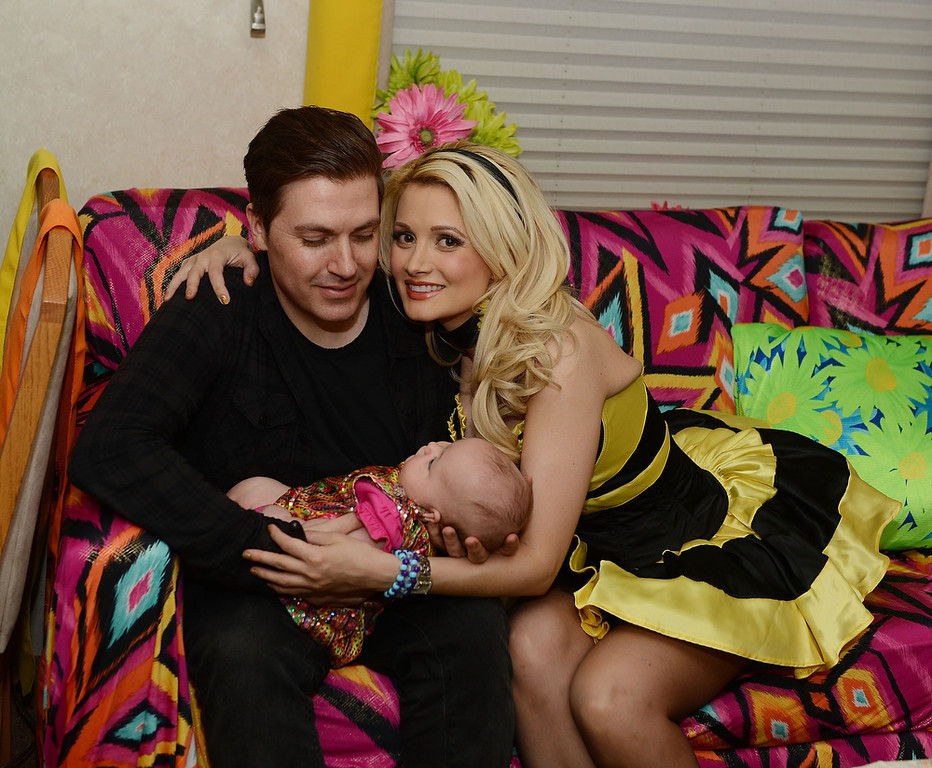 . Pasquale Rotella, Rainbow Aurora Rotella and Holly Madison pose for a portrait in a quiet room before the 17th annual Electric Daisy Carnival at Las Vegas Motor Speedway on June 21, 2013 in Las Vegas, Nevada. (Photo by Denise Truscello/Getty Images for Electric Daisy Carnival)
