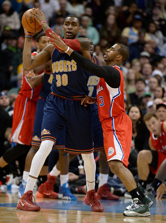 . Los Angeles Clippers guard Chris Paul (3) puts pressure on Denver Nuggets forward Quincy Miller (30) during the third quarter. (Photo by John Leyba/The Denver Post)