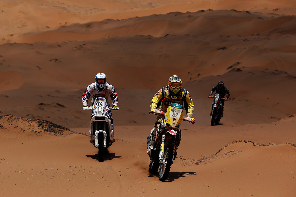 . EL SALVADOR, CHILE - JANUARY 17:  (#74) Henricus Vogels of the Netherlands for KTM Bas Dakar Team, (#52) Claudio Rodriguez of Chile for Tamarugal Honda Racing XC Rally Team and (#67) Robert Van Pelt from the Netherlands for Honda Team Van Pelt compete in stage 12 on the way to La Serena during Day 13 of the 2014 Dakar Rally on January 17, 2014 in El Salvador, Chile.  (Photo by Dean Mouhtaropoulos/Getty Images)
