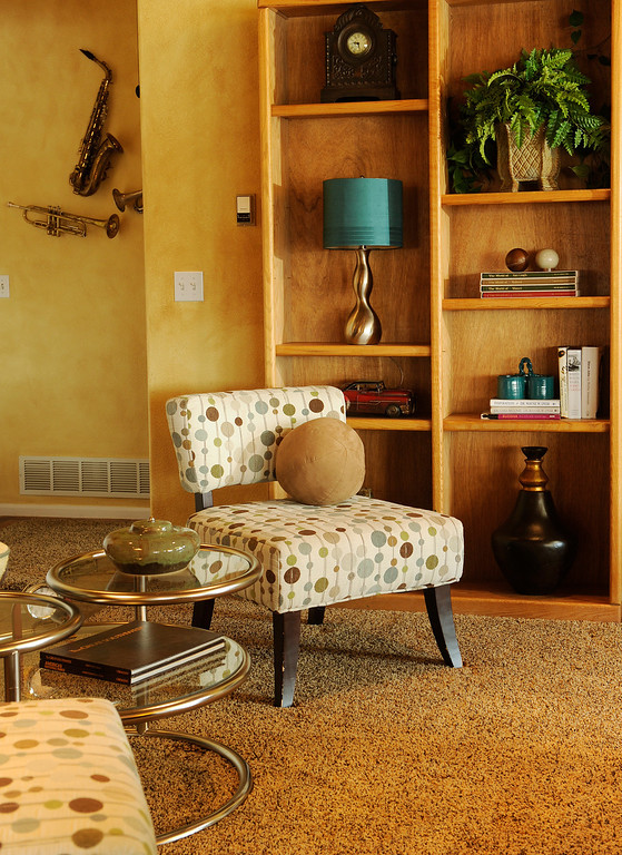 . An odd chrome table made of circles of glass was one of the few original piece of furniture - but the bubble-print chairs from the Green Mountain store accented it perfectly.  Photo by Cyrus McCrimmon, The Denver Post