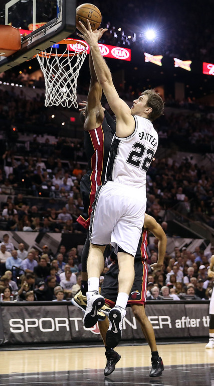. Tiago Splitter #22 of the San Antonio Spurs goes up for a dunk over Dwyane Wade #3 of the Miami Heat in the first half during Game Four of the 2013 NBA Finals at the AT&T Center on June 13, 2013 in San Antonio, Texas.  (Photo by Christian Petersen/Getty Images)