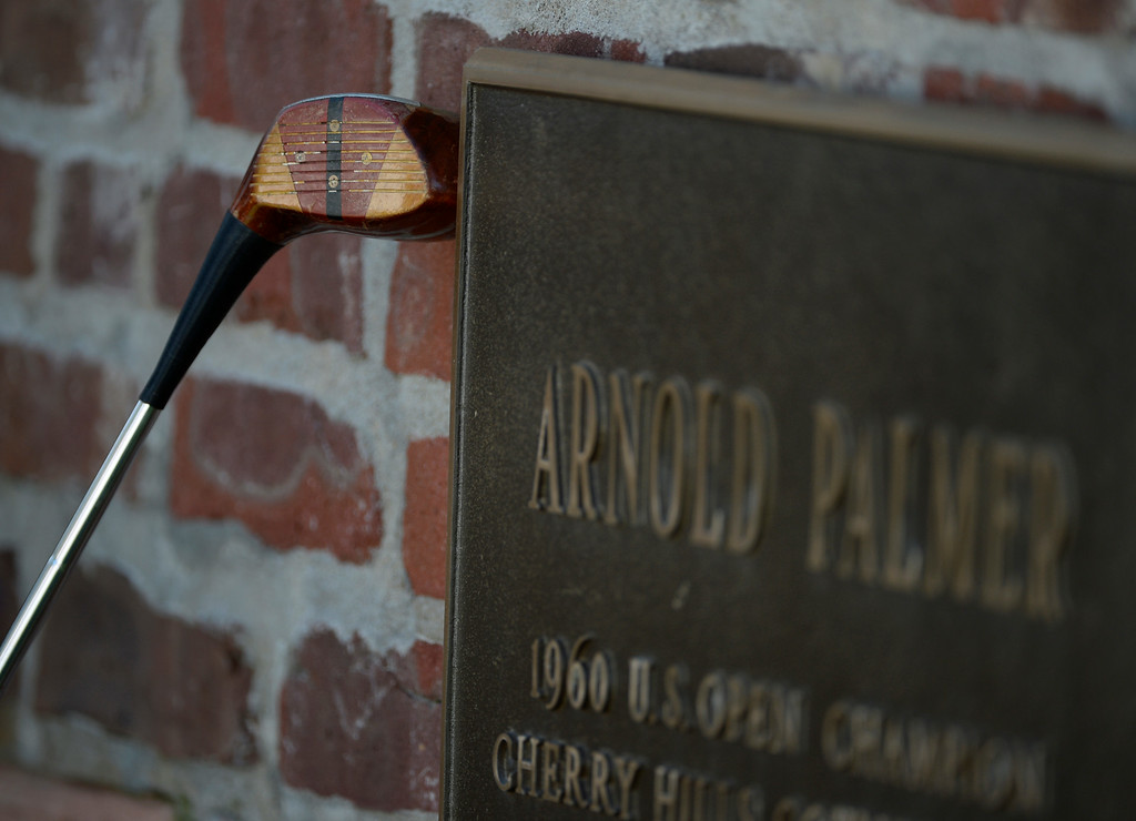 . CHERRY HILLS VILLAGE, CO. - SEPTEMBER 02:  A Persimmon wood golf club up against a brass plaque on hole #1 at the FedExCup BMW Championship at the Cherry Hills Country Club Tuesday, September 02, 2014. Several golfers used this club to try and reach the hole like Arnold Palmer did in the 1960 U.S. Open Championship. (Photo By Andy Cross / The Denver Post)