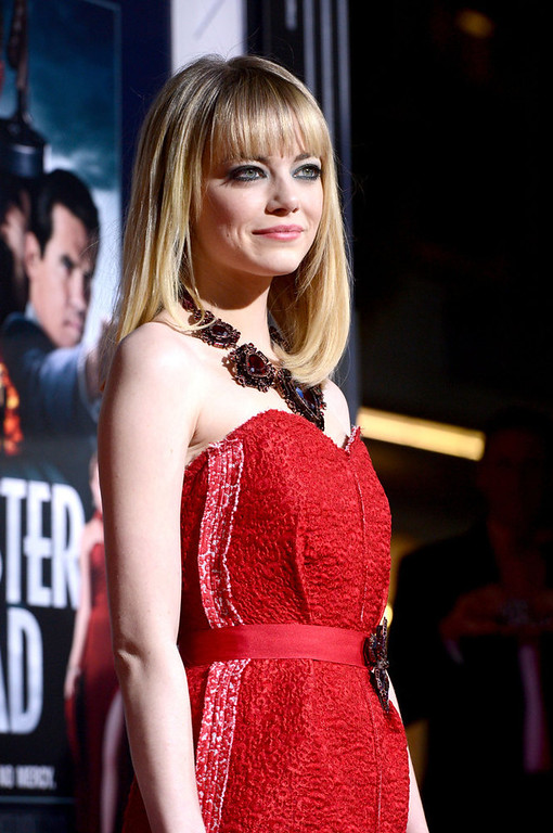 """. Actress Emma Stone arrives at Warner Bros. Pictures\' \""""Gangster Squad\"""" premiere at Grauman\'s Chinese Theatre on January 7, 2013 in Hollywood, California.  (Photo by Kevin Winter/Getty Images)"""