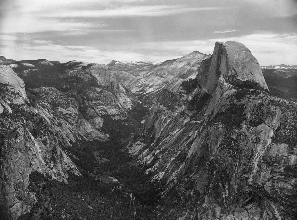 . One of the most famed vistas of Yosemite National Park on June 9, 1950 is from Glacier Point (3,000 feet above the valley) of the upper Yosemite Valley with half dome on the right and Mirror Lake central in the valley blow. Mirror Lake is the upper terminus of the Yosemite Valley highway. In the background Tenaya Creek and canyon winds its way off around Basket Dome to the upper reaches of the Park. AP Photo/Ernest Bennett)