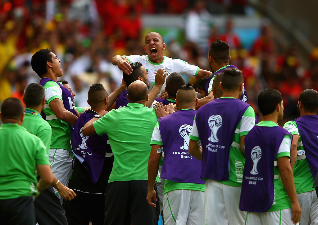 . BELO HORIZONTE, BRAZIL - JUNE 17: Sofiane Feghouli of Algeria (C) celebrates with teammates after scoring his team\'s first goal on a penalty kick during the 2014 FIFA World Cup Brazil Group H match between Belgium and Algeria at Estadio Mineirao on June 17, 2014 in Belo Horizonte, Brazil.  (Photo by Ian Walton/Getty Images)