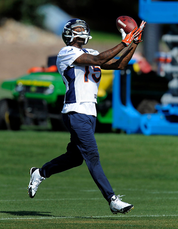 . Denver Broncos wide receiver Tavarres King (15) catches a pass during practice September 9, 2013 at Dove Valley. (Photo by John Leyba/The Denver Post)