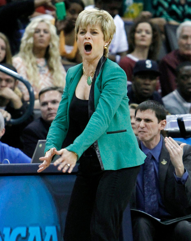 . Baylor\'s head coach Kim Mulkey reacts to a call against her team as they play against Louisville during a regional semifinal game in the women\'s NCAA college basketball tournament in Oklahoma City, Sunday, March 31, 2013.   (AP Photo/Alonzo Adams)
