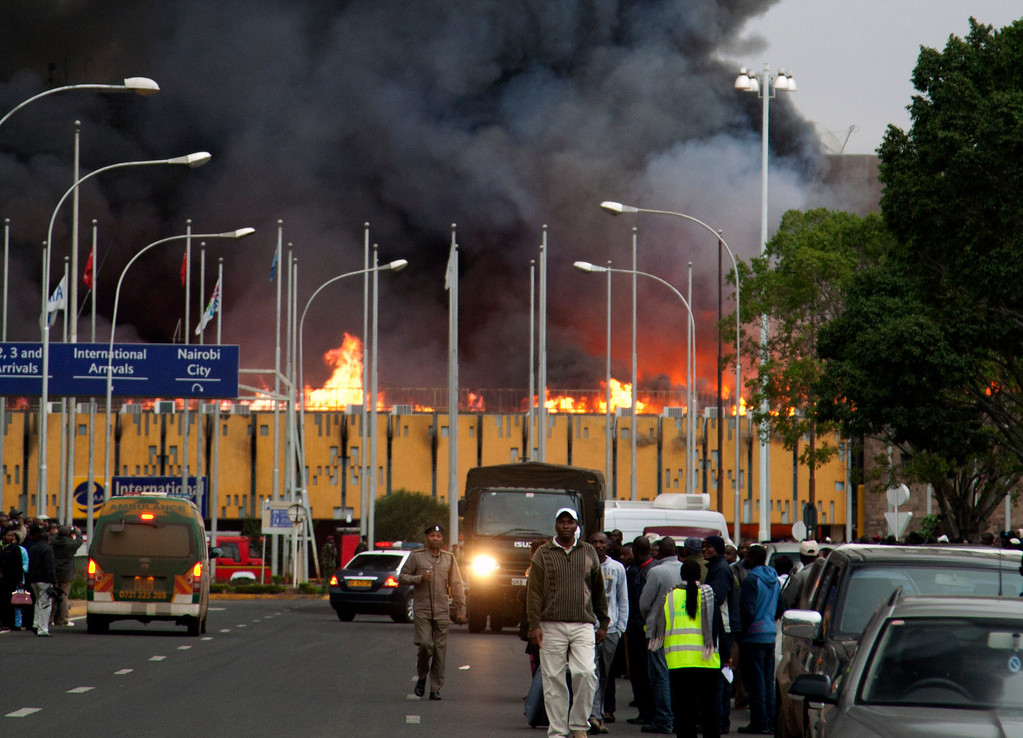 . Black smoke billow from the international arrival unit  of Jomo Kenyatta International Airport in Nairobi, Kenya, Wednesday, Aug. 7, 2013. A massive fire engulfed the arrivals hall at Kenya\'s main international airport early Wednesday, forcing East Africa\'s largest airport to close and the rerouting of all inbound flights. (AP Photo/Sayyid Azim)