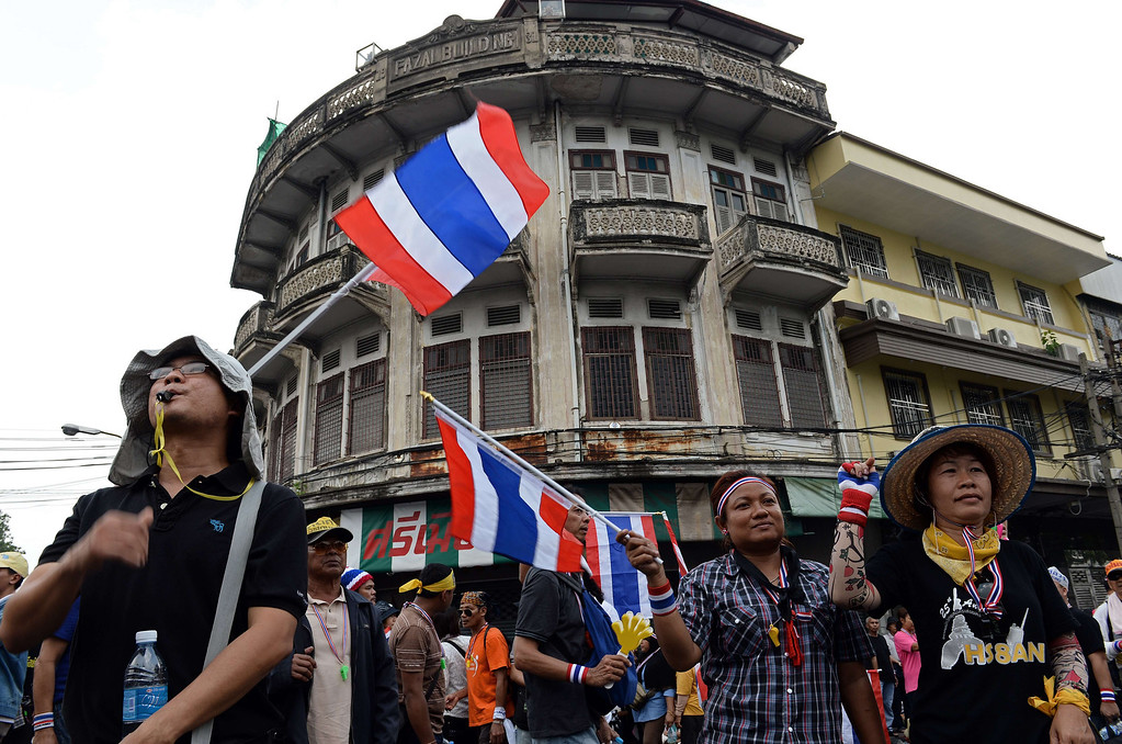 . Thai opposition protesters wave national flags during a rally at the Interior Ministry in Bangkok on November 26, 2013.   AFP PHOTO/Christophe ARCHAMBAULT/AFP/Getty Images