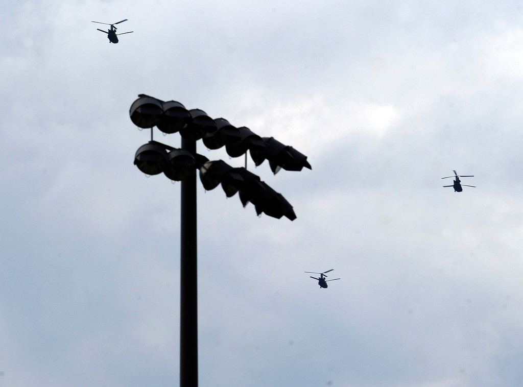 . HIGHLANDS RANCH, CO. - SEPTEMBER 13: Three Chinook helicopters flew over a suburban Denver ball field Friday night, September 13, 2013 on the way north to assist with flooding relief work this weekend.  Photo By Karl Gehring/The Denver Post
