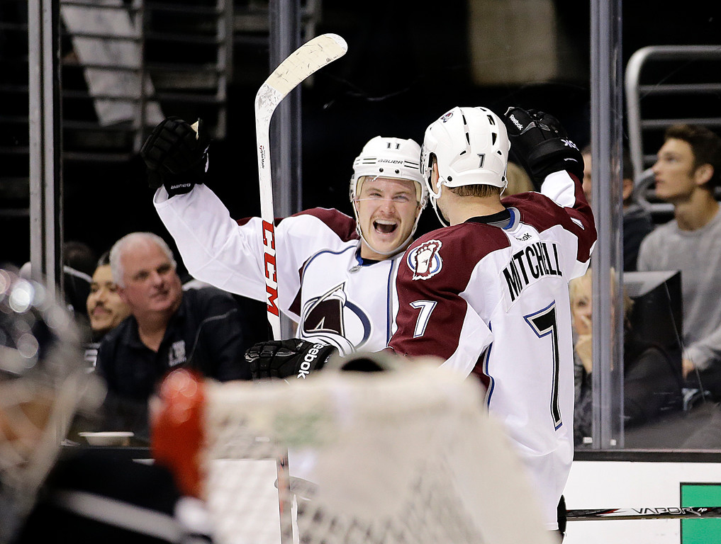 . Colorado Avalanche\'s Jamie McGinn, left, celebrates his game-winning goal with John Mitchell in overtime of an NHL hockey game on against the Los Angeles Kings Saturday, Nov. 23, 2013, in Los Angeles. The Avalanche won 1-0 in overtime. (AP Photo/Jae C. Hong)