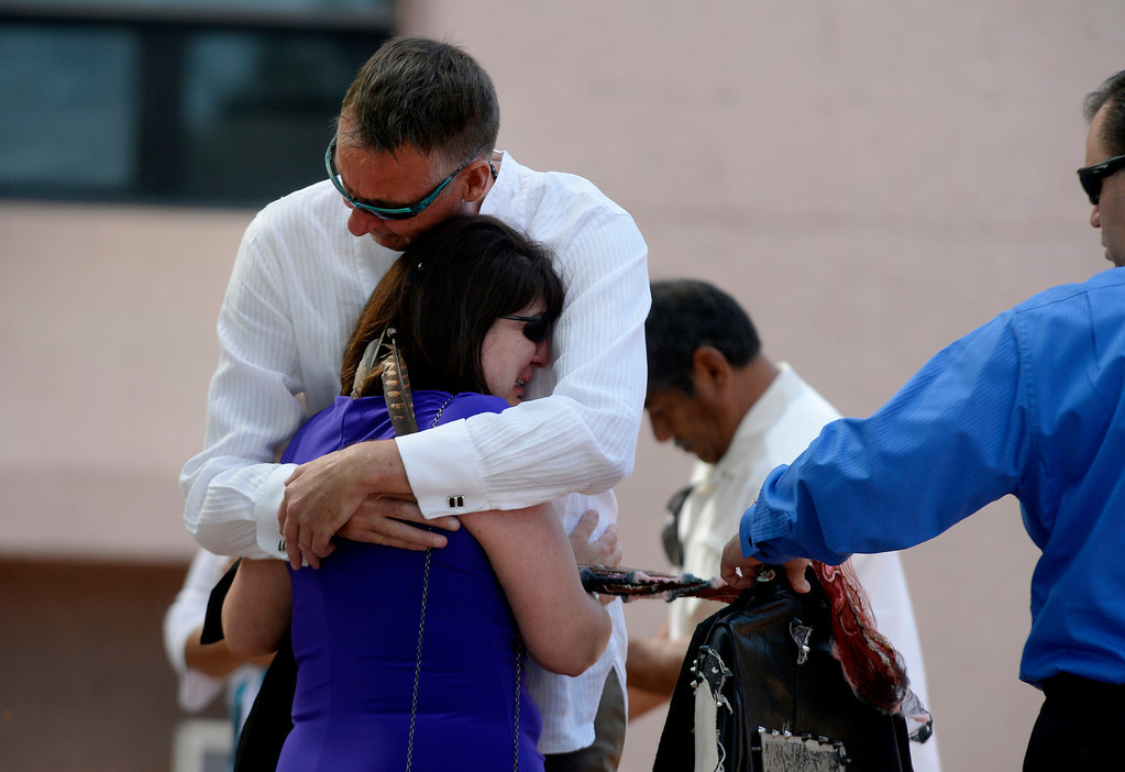 . Ron Quinlan and Glenda Aretxuloeta embrace during a memorial service for their son Wesley Quinlan and Wiyanna Nelson at the National Center for Atmospheric Research in Boulder, CO September 21, 2013. (Photo By Craig F. Walker / The Denver Post)
