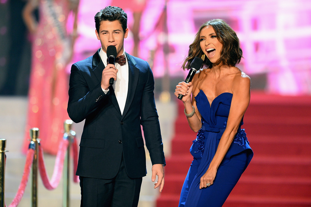 . Recording artist and host Nick Jonas (L) and television personality and host Giuliana Rancic (R) speak onstage during the 2013 Miss USA pageant at PH Live at Planet Hollywood Resort & Casino on June 16, 2013 in Las Vegas, Nevada.  (Photo by Ethan Miller/Getty Images)