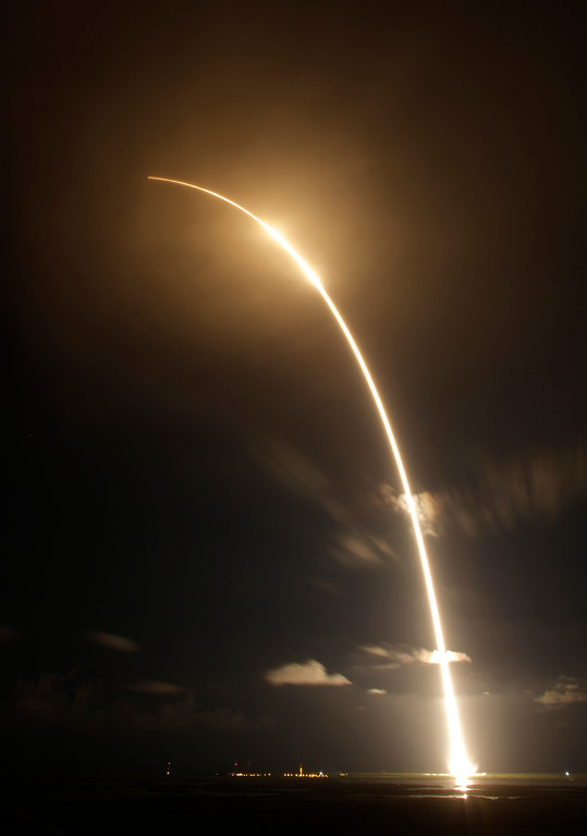. The Falcon 9 SpaceX rocket is shown in a time exposure as it lifts off from space launch complex 40 at the Cape Canaveral Air Force Station in Cape Canaveral, Fla. on Sunday, Oct. 7, 2012. The rocket is carrying supplies to the International Space Station. (AP Photo/Terry Renna)