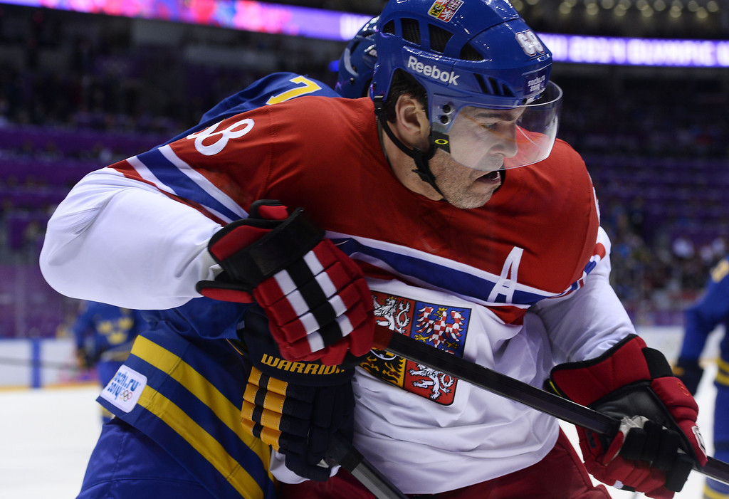 . Czech Republic\'s Jaromir Jagr (L) vies with Sweden\'s Niklas Hjalmarsson during the Men\'s Ice Hockey Group B match Czech Republic vs Sweden at the Bolshoy Ice Dome on February 12, 2014 at the Sochi Winter Olympics in Sochi.    JONATHAN NACKSTRAND/AFP/Getty Images
