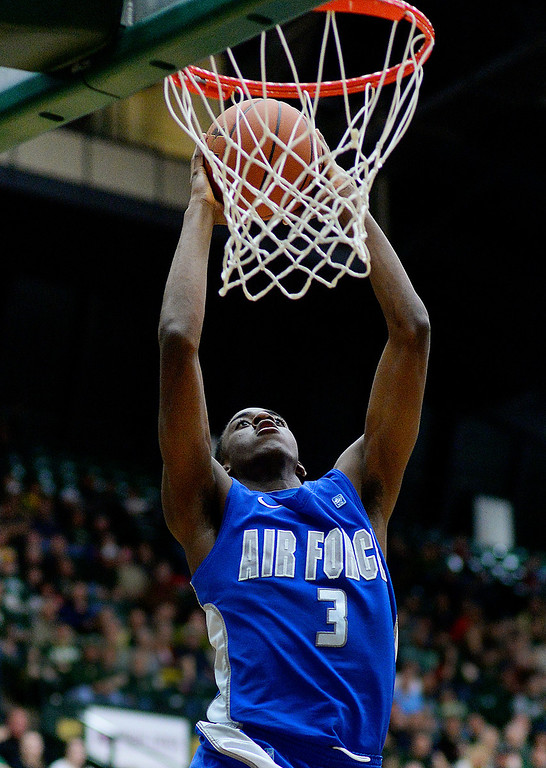 . FORT COLLINS, CO. - JANUARY 18:  Air Force junior forward Justin Hammonds approached the hoop for a dunk in the first half. The Colorado State men\'s basketball team hosted Air Force at Moby Arena in Fort Collins Saturday night, January 18, 2014. Photo By Karl Gehring/The Denver Post