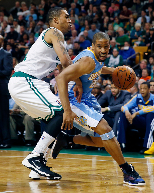 . Denver Nuggets\' Andre Miller (24) drives past Boston Celtics\' Courtney Lee (11) in the second quarter of an NBA basketball game in Boston, Friday, Dec. 6, 2013. (AP Photo/Michael Dwyer)