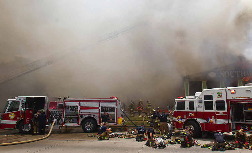 . Firefighters battle a fire at the Southwest Inn, Friday, May 31, 2013, in Houston. A fire that engulfed a Houston motel has injured at least six firefighters, including two critically, and three people are missing. (AP Photo/Houston Chronicle, Cody Duty)