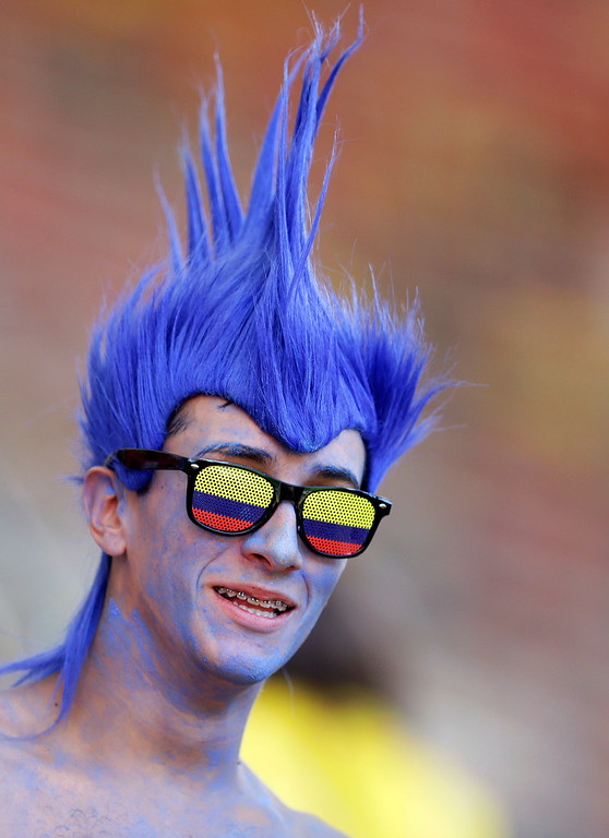 . A Colombia fan waits for the group C World Cup soccer match between Colombia and Ivory Coast at the Estadio Nacional in Brasilia, Brazil, Thursday, June 19, 2014.  (AP Photo/Themba Hadebe)