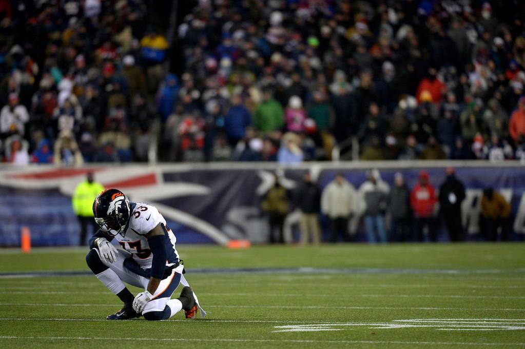 . Strong safety Duke Ihenacho #33 of the Denver Broncos is hurt vs the New England Patriots at Gillette Stadium in Foxborough MA, November 24, 2013 Denver. (Photo By Joe Amon/The Denver Post)